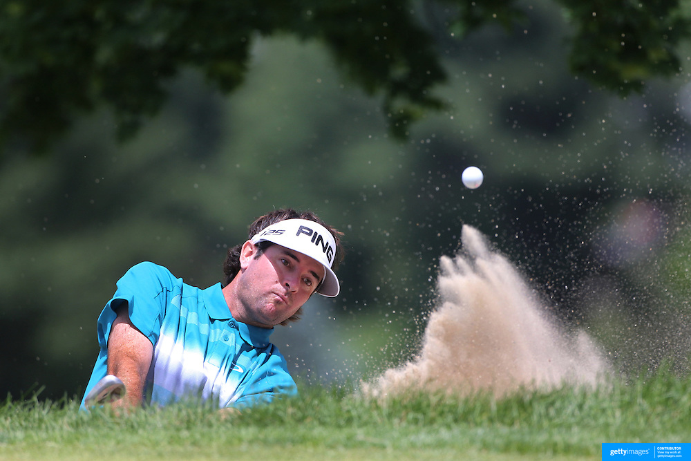 Bubba Watson, USA, chips out of the bunker on the second hole during the second round of the Travelers Championship at the TPC River Highlands, Cromwell, Connecticut, USA. 20th June 2014. Photo Tim Clayton