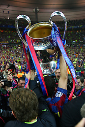 PARIS, FRANCE - WEDNESDAY, MAY 17th, 2006: FC Barcelona's Juliano Belletti lifts the European Cup as he disappears into a pack of photographers during the UEFA Champions League Final at the Stade de France. (Pic by David Rawcliffe/Propaganda)