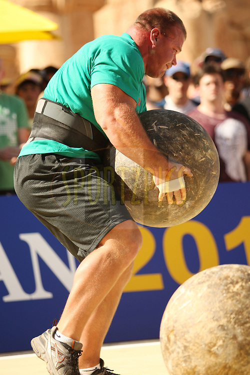Derek Poundstone (USA) keeps a tight grip on the Atlas Stone during the final rounds of the World's Strongest Man competition held in Sun City, South Africa.