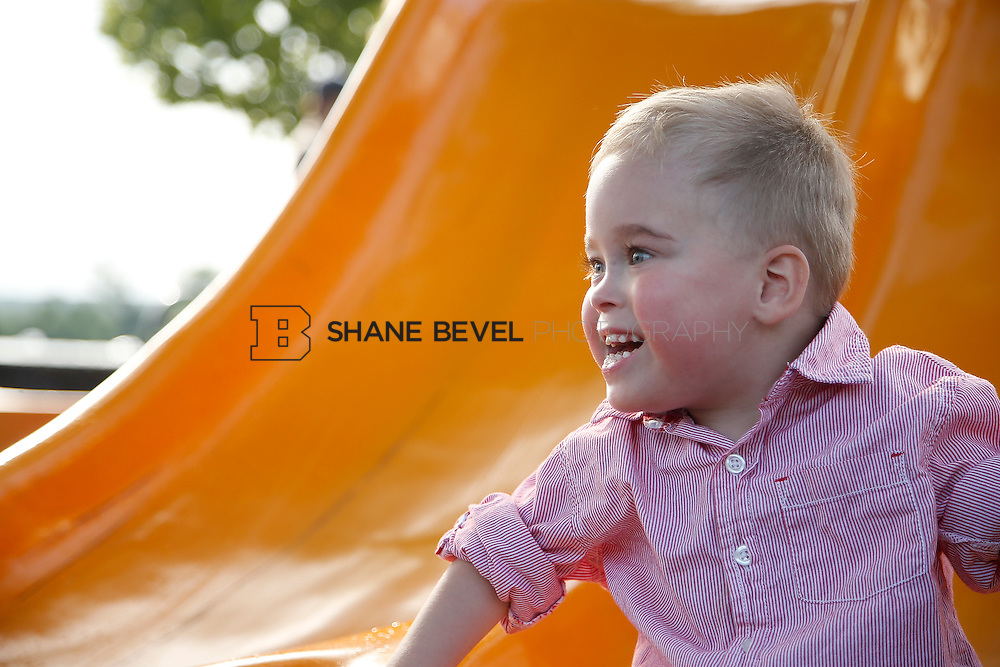5/28/15 6:05:35 PM -- Miracle Miles and his family pose for portraits and play at the QuikTrip park for the 2015 Saint Francis Health System advertising campaign. <br /> <br /> Photo by Shane Bevel
