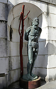 San Sebastiano, bronze sculpture, 2011, by Ettore Greco, in a niche at the Mausoleum at Vittoriale degli italiani, or The Shrine of Italian Victories, the home, estate and museums of Gabriele D'Annunzio, 1863-1938, Italian writer, soldier and fascist, at Gardone Riviera, Lake Garda, Brescia, Lombardy, Italy. The estate consists of the Prioria, where d'Annunzio lived 1922-38, an amphitheatre, the protected cruiser Puglia, the MAS vessel used by D'Annunzio in 1918 and a mausoleum. It is part of the Grandi Giardini Italiani. Picture by Manuel Cohen