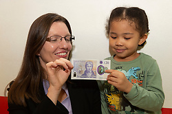 © Licensed to London News Pictures. 20/02/2020. London, UK.  3 year old Lily Ruva Tang poses with the new £20 banknote featuring  JMW Turner. Photo credit: Ray Tang/LNP