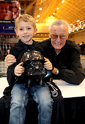 29 Jan 2012. New Orleans, Louisiana USA. <br /> Ben Varley (5 yrs) with Stan Lee, real life comic book hero, former president and chairman of Marvel Comics co-created some of the most enduring comic book heroes of our times. Lee's most notable characters include the Fantastic Four, Hulk, Spiderman, Thor, Iron Man, X-Men and many more. He appeared at Wizard World New Orleans Comic Con at the Ernest N Morial Convention Center. <br /> Photo; Charlie Varley/varleypix.com