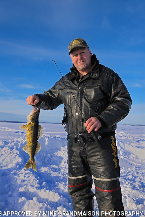 Ice fishing on Pakwash Lake<br />akwash Lake near Ear Falls<br />Ontario<br />Canada