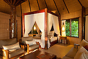 Interior of bure guest room at Matangi Private Island Resort, Fiji.