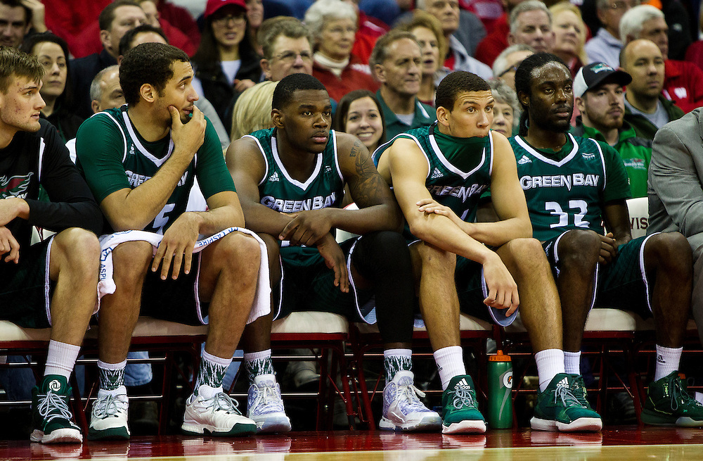 Members of the UW-Green Bay Men's Basketball team look on from the bench during the first second of the UW-Green Bay Men's Basketball game versus University of Wisconsin at the Kohl Center, Wednesday, December 14, 2016.