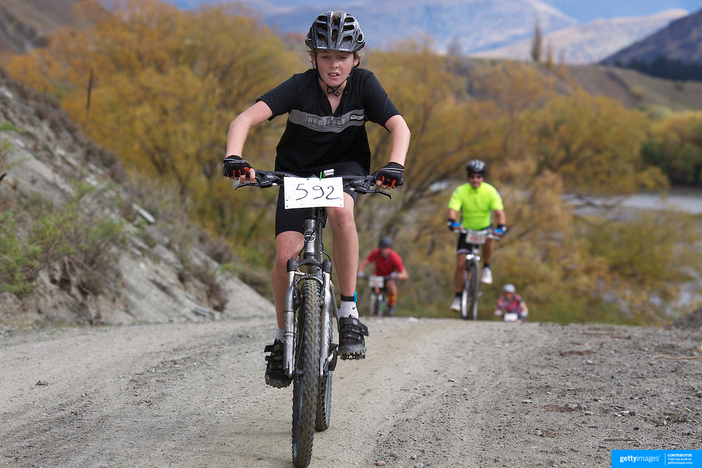 Will Sutherland in action during the New World Tour de Wakatipu bike race on Saturday. Six hundred and ninety people entered the bike race which featured an  exclusive course with breathtaking views from Millbrook Resort in Arrowtown to Chard Farm along the Kawarau River, via the trails and tracks of the Wakatipu basin with distances of 36 kilometres fun riding for recreational bikers and 45 kilometres for elite and sport racers. The event was part of the inaugural Queenstown Bike Festival, which took place from 16th-25th April. The event hopes to highlight Queenstown's growing profile as one of the three leading biking centres in the world. Queenstown, Central Otago, New Zealand. 23rd April 2011. Photo Tim Clayton..