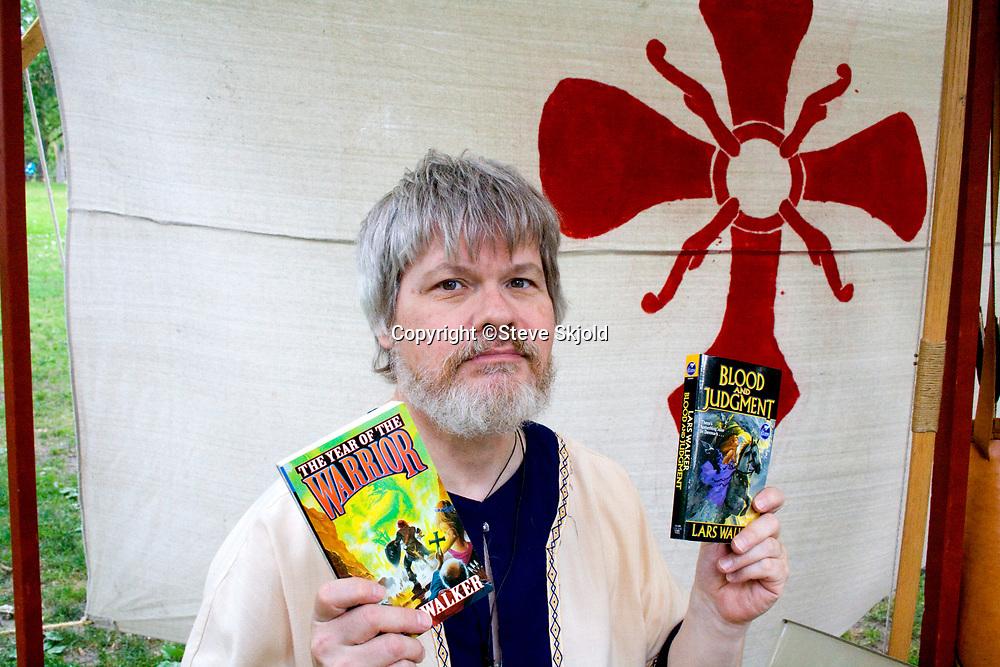 Author holding his books at Norway Day at Minnehaha Park. Minneapolis Minnesota MN USA