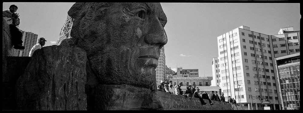 Statue Head and People, La Paz, Bolivia, 2003