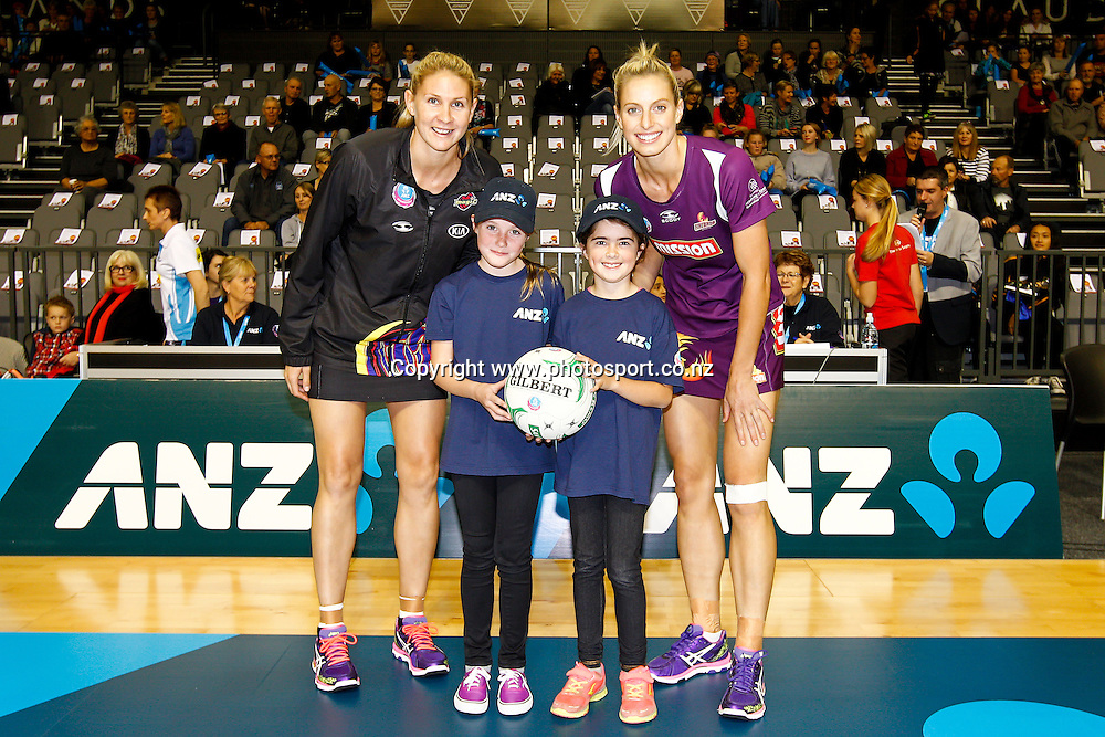 ANZ Future Captains - Bianka Eggink (L) aged 10 and Mollyrose O'Donell (R) aged 9 pose with Waikato BOP Magic captain Casey Kopua (L) and Queenslands Firebird captain Laura Geitz (R) ahead of the ANZ Championship netball match - Waikato BOP Magic v Queensland Firebirds at Claudelands Arena, Hamilton, New Zealand on Monday 2 June 2014.  Photo:  Bruce Lim / www.photosport.co.nz