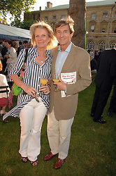NIGEL HAVERS and his wife GEORGINA at the 21st annual Macmillan Cancer Support Parliamentary Tug of War held in Westminster College Gardens, London on 10th June 2008.<br />