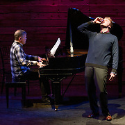 January 14, 2012 - Brooklyn, NY : .Pianist Marc Peloquin, left, plays as tenor Brandon Snook downs a shot in honor of Charles Ives during a marathon performance of Mr. Ives's work at the Galapagos Art Space in DUMBO, Brooklyn, on Saturday evening..CREDIT: Karsten Moran for The New York Times