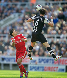 NEWCASTLE-UPON-TYNE, ENGLAND - Sunday, April 1, 2012: Liverpool's Luis Alberto Suarez Diaz in action against Newcastle United's Mike Williamson during the Premiership match at St James' Park. (Pic by David Rawcliffe/Propaganda)