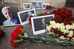 October 2, 2018 - Kiev, Kiev, Ukraine - Flowers, candles and portraits are seen on the ground during the tribute to late Charles Aznavour in front of the French Embassy..French-Armenian songwriter, singer and an actor Charles Aznavour aged 94 has died at his home in Alpilles in southeastern France after returning from a concert tour from Japan last month. (Credit Image: © Pavlo Gonchar/SOPA Images via ZUMA Wire)