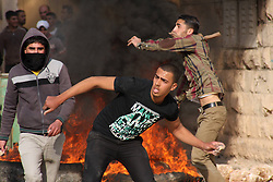 Palestinian protesters throw stones towards Israeli soldiers during clashes near the West Bank village of Tamoun, Israel, January 1, 2013. Photo by Imago / i-Images...UK ONLY