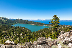 """Marlette Lake and Lake Tahoe 1"" - Photograph of both Marlette Lake and Lake Tahoe with boulders in the foreground."