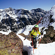 Lynsey Dyer hiking up for another run in Glacier National Park. This time dropping into basecamp.