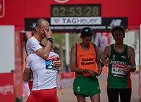 Marcin Grabinski POL is congratulated by his Guide Runner at the end of the World Para Athletics Marathon Championships T12 Men's Race. The Virgin Money London Marathon, 28 April 2019.<br /> <br /> Photo: Eddie Keogh for Virgin Money London Marathon<br /> <br /> For further information: media@londonmarathonevents.co.uk
