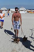 MIAMI, FL,USA  SIMON COWELL WALKING HIS DOGS ON THE BEACH OF MIAMI<br /> ©Exclusivepix