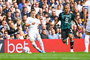 Leeds United defender Ezgjan Alioski (10) passes the ball away from Swansea City forward Andre Ayew (22) during the EFL Sky Bet Championship match between Leeds United and Swansea City at Elland Road, Leeds, England on 31 August 2019.