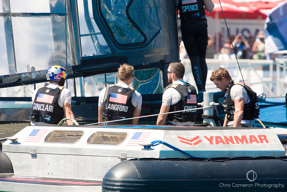 The Great Sound, Bermuda, 18th June. Oracle Team USA sailors Louis Sinclair (ATG), Kyle Langford (AUS), Kinley Fowler (AUS) and Tom Slingsby (AUS) after their fourth loss in a row to Emirates Team New Zealand. Day two of the America's Cup.
