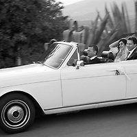 A couple leave the church in their wedding car in Poble Espanyol, Montjuic, Barcelona, Spain, Europe.