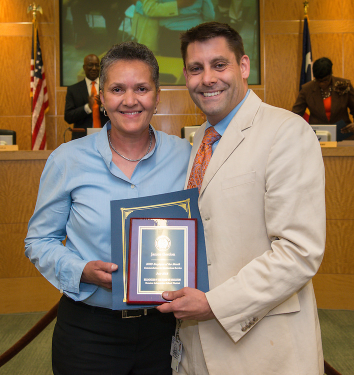 Employee of the Month Janice Gordon and Todd Paulus pose for a photograph during a meeting of the Board of Trustees, June 9, 2016.