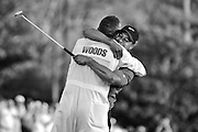 (04/10/05) -- Augusta, GA -- MASTERS --   Tiger Woods celebrates his Masters victory with his caddie Steve Williams after sinking the winning put in a playoff hole on No. 18 during Sunday's final round of The Masters at Augusta National Golf Club. Gerry Melendez photo