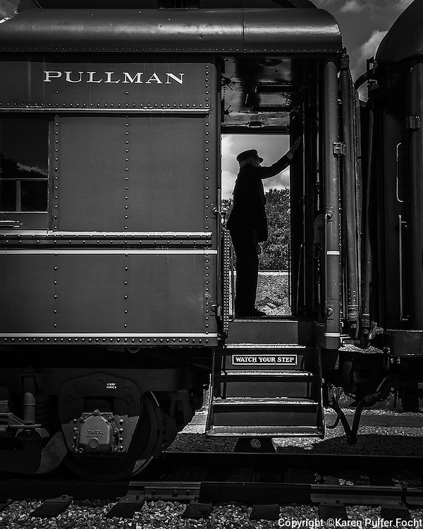 Mark Brainard, a Station Master, stands in the vestibule of a Pullman passenger car at the Chattanooga Railfest, recently. This car, the Tennessee Valley Clover Colony is of the colony series is from the 1920's. It was used in the film Some Like It Hot.