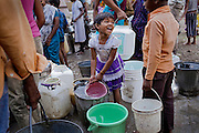 A girl is busy collecting potable drinking water delivered by a government truck in Oriya Basti, one of the water-affected colonies near the abandoned Union Carbide (now DOW Chemical) industrial complex in Bhopal, Madhya Pradesh, India, site of the infamous 1984 gas tragedy. The poisonous cloud that enveloped Bhopal left everlasting consequences that today continue to consume people's lives.