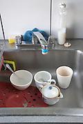 kitchen sink with dirty kitchenware