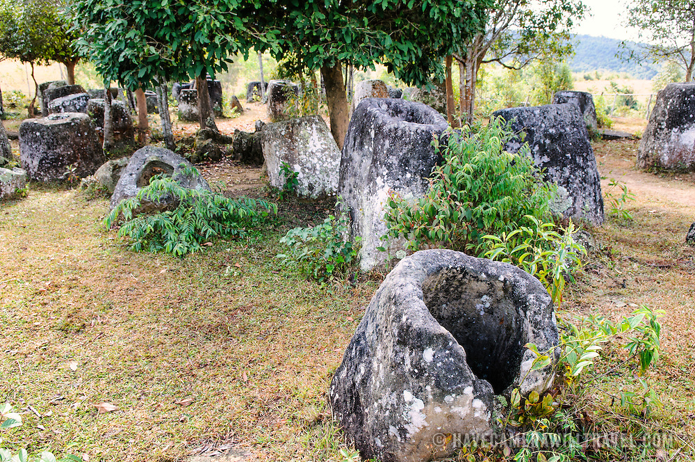 Cluster of stone jars at Site 3 of the Plain of Jars in north-central Laos. Much remains unknown about the age and purpose of the thousands of stone jars clustered in the region. Most accounts date them to at least a couple of thousand years ago and theories have been put forward that they were used in burial rituals.