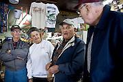 Francis Buchanan, Cookie Currin, Wilson Fleming, and C.B. Curtis at Buchanan's Store.