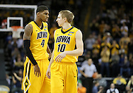 January 19 2013: Iowa Hawkeyes guard/forward Roy Devyn Marble (4) and guard Mike Gesell (10) during the first half of the NCAA basketball game between the Wisconsin Badgers and the Iowa Hawkeyes at Carver-Hawkeye Arena in Iowa City, Iowa on Sautrday January 19 2013. Iowa defeated Wisconsin 70-66.