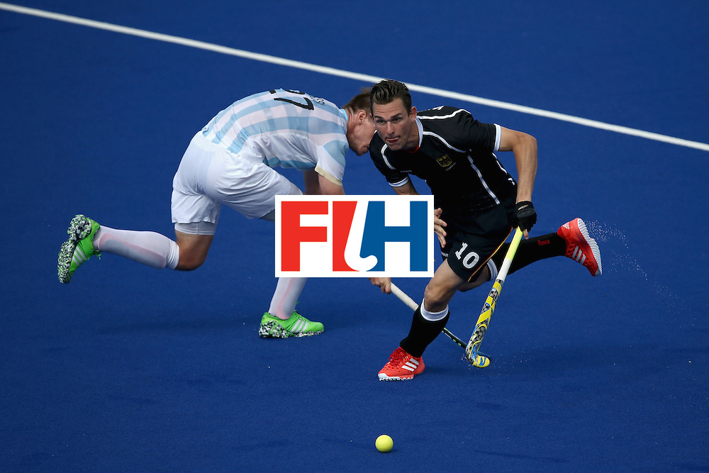RIO DE JANEIRO, BRAZIL - AUGUST 11:  Christopher Wesley #10 of Germany steals the ball from Lucas Rossi #27 of Argentina  during a Men's Preliminary Pool B match on Day 6 of the Rio 2016 Olympics at the Olympic Hockey Centre on August 11, 2016 in Rio de Janeiro, Brazil.  (Photo by Sean M. Haffey/Getty Images)
