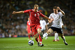 BIRMINGHAM, ENGLAND - Tuesday, October 14, 2008: Wales' Jack Collison and England's James Milner challenge for the ball during the UEFA European Under-21 Championship Play-Off 2nd Leg match at Villa Park. (Photo by Gareth Davies)