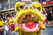 31 JANUARY 2014 - BANGKOK, THAILAND:   A Chinese Lion dance troupe performs on Yaowarat Road during Lunar New Year festivities, also know as Tet and Chinese New Year, in Bangkok. This year is the Year of the Horse. The Lion Dance scares away evil spirits and brings prosperity and luck. Ethnic Chinese make up about 14% of Thailand and Chinese holidays are widely celebrated in Thailand.     PHOTO BY JACK KURTZ