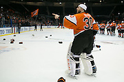 RIT goaltender Mike Rotolo, a Rochester native, points to fans after RIT defeated Robert Morris University to win the Atlantic Hockey final at the Blue Cross Arena in Rochester on Saturday, March 19, 2016.