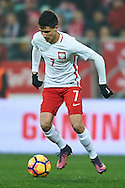 Wroclaw, Poland - 2016 November 14: Bartosz Kapustka of Poland controls the ball during Poland v Slovenia - International Friendly Soccer Match at Municipal Stadium on November 14, 2016 in Wroclaw, Poland.<br /> <br /> Adam Nurkiewicz declares that he has no rights to the image of people at the photographs of his authorship.<br /> <br /> Picture also available in RAW (NEF) or TIFF format on special request.<br /> <br /> Any editorial, commercial or promotional use requires written permission from the author of image.<br /> <br /> Mandatory credit:<br /> Photo by © Adam Nurkiewicz / Mediasport