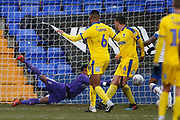 Nathan Trott of Wimbledon  saves but can't keep the rebound out from Rushian Hepburn-Murphy of Tranmere Rovers (not pictured) during the EFL Sky Bet League 1 match between Tranmere Rovers and AFC Wimbledon at Prenton Park, Birkenhead, England on 21 December 2019.