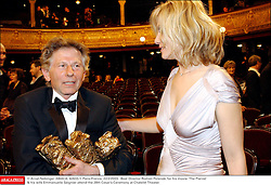 File photo : Best Director Roman Polanski for his movie 'The Pianist' & his wife Emmanuelle Seigner attend the 28th Cesar's Ceremony at Chatelet Theater in Pari, France, February 22, 2003. Film director Roman Polanski has given up a chance to preside over the Cesar awards - France's equivalent of the Oscars, his lawyer said on Thursday after the decision to hand him the role caused outrage among women's groups, who had called for protests. Their anger is caused by the fact Polanski has been wanted in the US for almost four decades for the rape of a 13-year-old girl in Los Angeles in 1977. Photo by Arnal-Nebinger/ABACAPRESS.COM