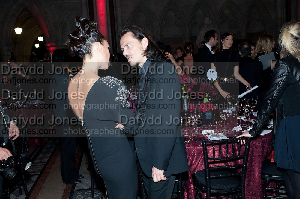 VICTORIA BECKHAM; MATTHEW WILLIAMSON, British Fashion awards 2009. Supported by Swarovski. Celebrating 25 Years of British Fashion. Royal Courts of Justice. London. 9 December 2009