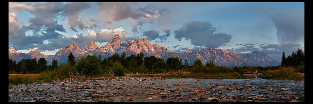 Morning clouds passing over the Grand Teton range at Schwabacher Landing in Grand Teton National Park.