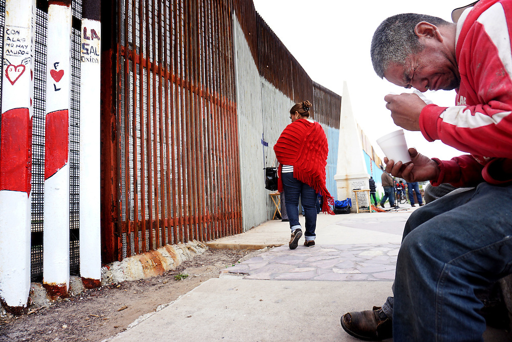 TIJUANA, MEX-FEB 22: A deportee named Hector weeps during a Worship service along the U.S.-Mexico border wall in Tijuana, Mexico on Sunday, February 22, 2015.   Senior Republican senators said they expected Congress will avoid a shutdown over the Department of Homeland Security, which faces a partial shutdown on Feb. 27 over a GOP push to roll back President Barack Obama's executive actions on immigration.(Photo by Sandy Huffaker/Getty Images)