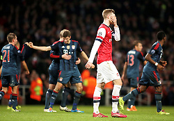 19.02.2014, Emirates Stadion, London, ENG, UEFA CL, FC Arsenal vs FC Bayern Muenchen, Achtelfinale, im Bild Per Mertesacker (Arsenal FC #4) enttaeuscht nach dem 2:0 durch Thomas Mueller (FC Bayern Muenchen #25) // during the UEFA Champions League Round of 16 match between FC Arsenal and FC Bayern Munich at the Emirates Stadion in London, Great Britain on 2014/02/19. EXPA Pictures © 2014, PhotoCredit: EXPA/ Eibner-Pressefoto/ Schueler<br /> <br /> *****ATTENTION - OUT of GER*****