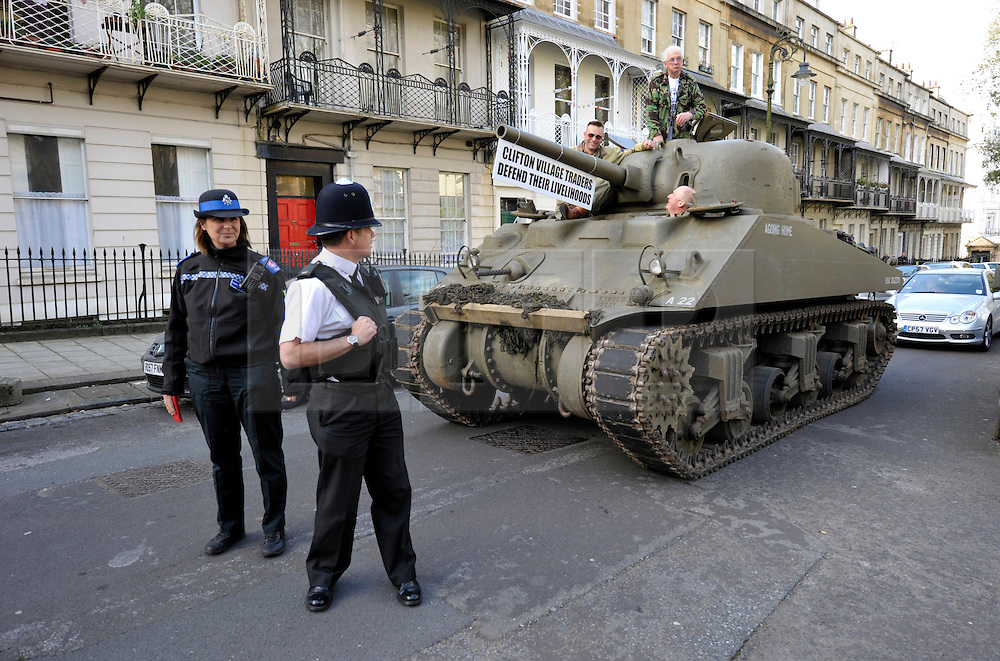 LNP HIGHLIGHTS OF THE WEEK 11/04/14 © Licensed to London News Pictures. 09/04/2014; Bristol, UK.  Tony Miles, (white hair and glasses) aka Smiley Miley from the Radio 1 Roadshow, rides in a WW2 Sherman tank through local streets in a protest by residents and traders from Clifton Village in Bristol about plans for a Residents Parking Scheme in their area from Bristol's elected Mayor, George Ferguson.  They say the business and social life of the area will be hit very hard by the RPS with customers and visitors unable to park, and that some businesses will have to close or move away from the area.  The tank is a symbol of defending their area against RPS.<br />