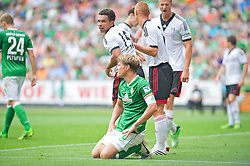 "28.07.2013, Weserstadion, Bremen, GER, 1.FBL, ""Tag der Fans 2013"" des SV Werder Bremen, Testspiel SV Werder Bremen vs Fulham FC, im Bild Clemens Fritz (SV Werder Bremen #8) kniend nach vergebener Grosschance // during the ""Tag der Fans 2013"" of the German Bundesliga Club SV Werder Bremen at the Weserstadion, Bremen, Germany on 2013/07/28. EXPA Pictures © 2013, PhotoCredit EXPA Andreas Gumz ***** ATTENTION - OUT OF GER *****"