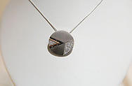 A 14 carat white pendant with white and black diamonds and a hint of rose gold at Karen Marie Jewelers in Cedar Rapids on Tuesday, January 29, 2013.