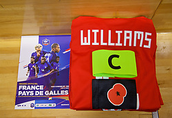 PARIS, FRANCE - Friday, November 10, 2017: The Wales shirt of captain Ashley Williams laid out in the dressing room along with an armband featuring a red poppy, before the international friendly match between France and Wales at the Stade de France. (Pic by David Rawcliffe/Propaganda)