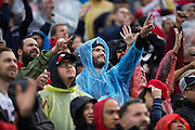 Fans wear ponchos during a rainy NFL game between the San Francisco 49ers and the New England Patriots at Levi's Stadium in Santa Clara, Calif., on November 20, 2016. (Stan Olszewski/Special to S.F. Examiner)